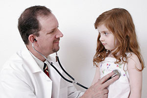 imagepointphoto :  doctor listening to a child's heart
